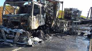 A truck was allegedly petrol-bombed during a service delivery protest on the N2 near Magabeni, south of Durban on Wednesday. Picture supplied.