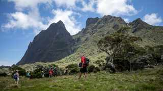 Hikers on the Plaine de Tamarins on Reunion Island, which provides a respite from the steep hills elsewhere on the trail to La Nouvelle in Mafate. The coast of this former French colony is plagued by sharks, but its interior is an outdoorsy paradise. Picture: Gulshan Khan/The New York Times.