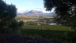 High on a hill in Devon Valley sits a stately winery named Le Grand Domaine, an unlikely place for a braai but that's exactly what was in store for us.