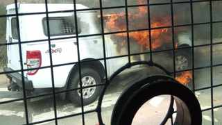 Students set alight a police van during a protest at UniZulu on Monday Picture: Supplied