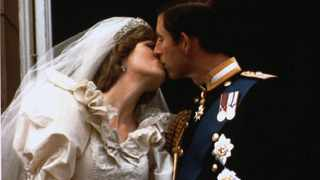 Prince Charles kisses his new bride Diana on their wedding day in London in a July 29, 1981 file photo. Picture: Reuters