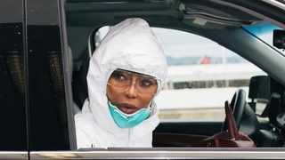 Supermodel Naomi Campbell wore a full hazmat suit, complete with goggles, a surgical mask and pink rubber gloves on a recent flight. Picture: Instagram.