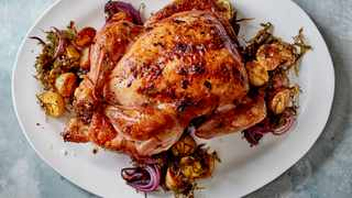 Roasted chicken seasoned with seaweed butter, and served with crisp kelp, red onions and potatoes, in Berkeley, Calif., April 2019. Kelp is delectable and nutritious, it's easy to cook with, and it actively benefits the ocean's health. Food styled by Vivian Lui. (Romulo Yanes/The New York Times)