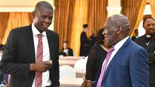 Justice Minister Ronald Lamola chats with Police Minister Bheki Cele on the sidelines of a meeting with religious leaders on the coronavirus outbreak. Picture: GCIS