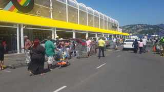 Long queues were seen outside the Makro in Springfield Park in Durban on Tuesday as people flocked to stock up ahead of the lockdown on Thursday. Picutre: Leon Lestrade / African News Agency / ANA