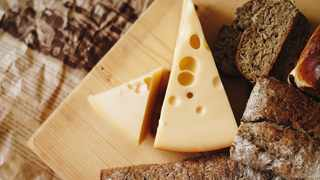 """So why does Swiss cheese have holes? Also called """"eyes,"""" they're so essential to Swiss cheese that when they're missing, the cheesemakers say the batch is """"blind."""" PICTURE: UNSPLASH"""