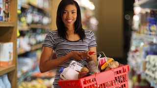 Young mom running errands at the supermarket. Picture: Supplied