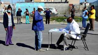 People wait to be screened at a Covid-19 community screening and testing site in Delft South, Cape Town. Picture:Brendan Magaar/African News Agency (ANA)