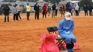 A medical practitioner awaits for patients to test for Covid-19 in Alexandra township. Picture: Itumeleng English/African News Agency (ANA)