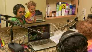 In an undated image provided by Andy Baldwin, Candace Valenzuela speaks on a video call from her bathroom office with her toddler, Cinto, on her lap. Picture: Andy Baldwin via The New York Times