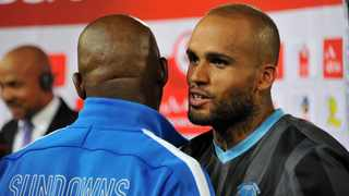 FILE - Maritzburg United's Orlando Smeekes speaks to Pitso Mosimane after being named man-of-the-match during their game against Mamelodi Sundowns in 2013. Photo: Samuel Shivambu/BackpagePix