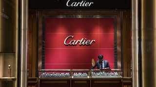 "An employee prepares for customers at the Cartier concession, a unit of  Richemont, at the Watches of Switzerland Group  flagship retail store on Regent Street in London, UK. The chairman of Swiss watch empire Richemont poured cold water on the luxury industry's hopes of a quick rebound from the coronavirus, warning of ""grave economic consequences"" that could last three years. Photo: Simon Dawson/Bloomberg"