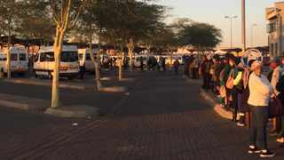 Commuters queue for transport at the Mabopane Taxi Rank. Picture: James Mahlokwane