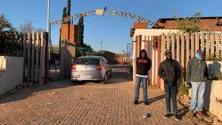 Teachers and members of the governing body at the entrance to Mamelodi High School. Picture: Sakhile Ndlazi