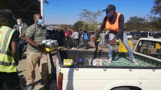People load their alcohol at Makro Silver Lakes. Picture: Zelda Venter