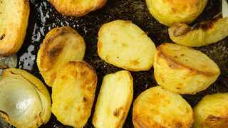 Struggling to get your roast potatoes fluffy on the inside and crispy on the outside? Picture: Wallpaper Flare