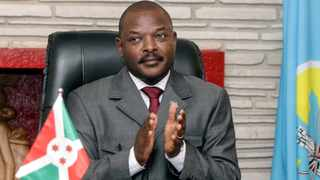 FILE PHOTO: Burundi President Pierre Nkurunziza claps after signing the new constitution at the Presidential Palace in Gitega Province, Burundi June 7, 2018. REUTERS/Evrard Ngendakumana/File Photo