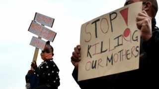 Eersterus residents protest outside the home of Evelyn de Kock who was killed - allegedly by her boyfriend - on Sunday. Picture: Oupa Mokoena/African News Agency (ANA)