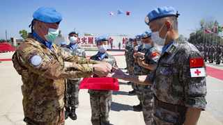 UNIFIL Commander Stefano Del Col awards a UN medal to Chinese peacekeepers during a ceremony at the Chinese troops' camp in Hanniyah village in southern Lebanon. Photo by: Xinhua