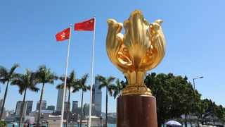 China's national flag and the flag of the Hong Kong Special Administrative Region on the Golden Bauhinia Square in Hong Kong, south China. Photo by: Xinhua/Wu Xiaochu)