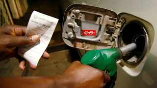 A petrol attendant fuels a car at a filling station in Harare, Zimbabwe. Picture: Philimon Bulawayo/Reuters