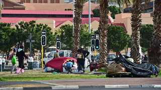 Homeless people sleep on the streets outside the Castle of Good Hope in Cape Town's CBD. Picture: Henk Kruger/ANA Pictures