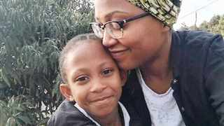 Amile, who desperately needs a new liver, with her mother, Phiwo Hlongwane.