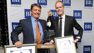 Paul Marais and Mike Estment pose with Raging Bull Award and certificate for the NFB Ci Cautious Fund of Funds. Photo: Bheki Radebe