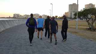Acting-President Cyril Ramaphosa seen walking on Sea Point Promenade with former finance minister Trevor Manuel. Picture: Greer Blizzard