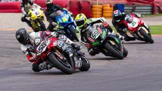 Michael White (58, Yamaha) leads David McFadden (69, Kawasaki) in the SuperGP race. Picture: Paul Bedford