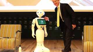 Nedbank's chief executive Mike Brown  with Pepper.