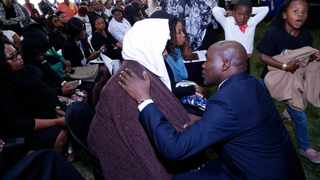 KZN MEC for Transport, Community Safety and Liaison Mxolisi Kaunda consoles Zandile Mbonambi, the mother of murdered Taxify driver Siyabonga Ngcobo during her son's funeral in Inanda on Sunday. Picture: Mbuyiselo Ndlovu