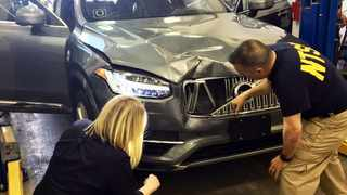 Investigators examine a driverless Uber Volvo XC90 that fatally struck a woman in Arizona. Picture: National Transportation Safety Board via AP.