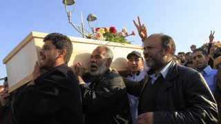 Libyan mourners attend the funeral of the people who were killed after air strikes by coalition forces on Wednesday night, at the martyrs' cemetery in Tripoli.