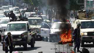 FIERY PROTESTS: Police remove a blockade set up by anti-government protesters during a demonstration to demand the ousting of Yemens President Ali Abdullah Saleh, in the city of Taiz. Picture: Reuters