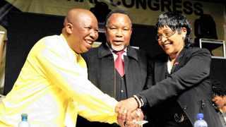 Julius Malema is congratulated by deputy president Kgalema Motlanthe and Winnie Madikizela-Mandela after being re-elected as president of the ANC youth league. Picture: Bongiwe Mchunu