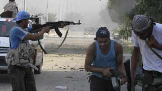 Libyan rebel fighters fire their weapons during a fight for the final push to flush out Muammar Gaddafi's forces in Abu Salim district in Tripoli.