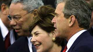 Former US President George W. Bush (R), his wife Laura and former US Secretary of State Colin Powell at the Kyoto Protocol summit. Picture: Jeff J Mitchell