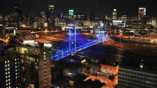 The Nelson Mandela Bridge adds a burst of splendour to the night skyline of the city of Gold. Picture: Steve Lawrence