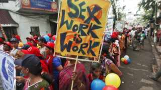 Participants take part in a rally as part of the week-long sex workers' freedom festival at the Sonagachi Red-light area in Kolkata.