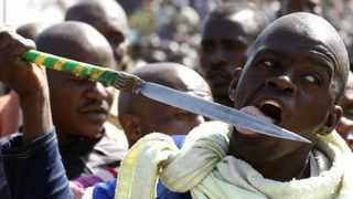 (File photo) A protester licks his spear outside the mine.