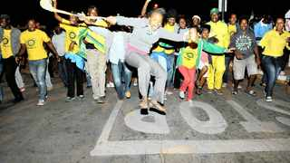 255 Malema supporters sing outside Nirvana community hall in Polokwane ass they wait for the night vigil to begin. 250912. Picture: Bongiwe Mchunu