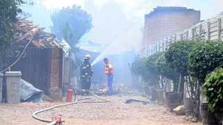 07/12/12 Members of the Tshwane Emergency services put out a fire at Tecno Chem factory in Pretoria North.  Picture: Oupa Mokoena