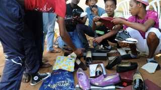 Showing off: Teenagers in Mofolo, Soweto, compare expensive shoes and brand-name clothes. The izikhothane are a disturbing reminder of the brokenness of our past  and our present, says the writer. Picture: Dumisani Dube