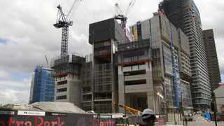 A construction site for new apartments is seen in central Sydney March 6, 2013. Australia's economy grew at a moderate pace last quarter as a long-awaited surge in resource exports helped offset softness elsewhere, while recent evidence suggests the growth pulse might have quickened since the start of the year.