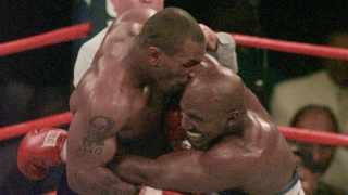FILE - Mike Tyson bites into the ear of Evander Holyfield in the third round of their WBA Heavyweight match on June 28, 1997, at the MGM Grand in Las Vegas. Photo: AP