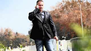 416 30.04.2013 Duncan D'Ewes, speaks on his phone outside the Sandton City, his former girlfriend has been stalking him for the past 8 months and hijacked all D'Ewes's accounts.  Picture: Itumeleng English