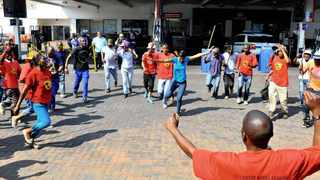 11/09/2013. Striking petrol attendants picket outside an Engen petrol station in Pretorius Street  Picture: Masi Losi