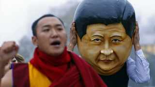 A protester wearing a giant head representing China's President Xi Jinping takes part in a demonstration calling Xi out for rights violations in Tibet in front of the European headquarters of the United Nations in Geneva on Tuesday.