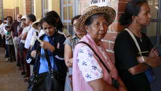 People line up before voting at a polling centre in the capital Antananarivo. Madagascar began voting in a presidential election they hope will end a five-year crisis and rebuild investor confidence to mend an economy crippled since President Andry Rajoelina seized power in a 2009 coup. REUTERS/Thomas Mukoya